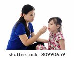 girl takes medicine from mother'... | Shutterstock . vector #80990659