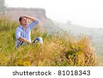 young man rest on wheat field | Shutterstock . vector #81018343