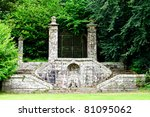 garden  with stone walls of a monastery in france - stock photo