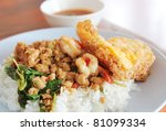 Thai food Rice and basil. Thai food, minced pork ,shrimp ,eggs fried with chilli pepper and sweet basil. Close-up with shallow depth of field. - stock photo