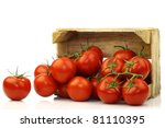 Fresh Tomatoes On The Vine In A ...