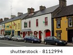 Colorfully Painted Storefronts on Main Street in Adare, Ireland - stock photo