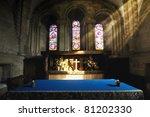 Cross Illuminated At The Altar...