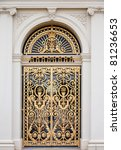 Golden ornate door - stock photo