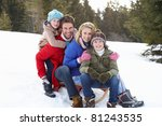 Young Family Sitting On A Sled...