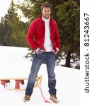 Young Man With Sled In Alpine...