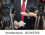 Small photo of close up of conference meeting microphones and businessman