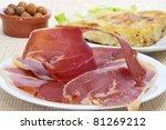 some spanish tapas, as tortilla de patatas, serrano ham and olives - stock photo