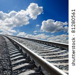 low view to railroad under deep blue cloudy sky - stock photo