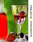 Rose wine and fruits. - stock photo