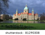 Stock photo breaks of sun shining on hannover new town hall after the rain storm in hannover germany 81290308