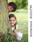 Two Little Children Hiding...