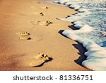 Footsteps On The Beach By The...