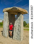young girl near big dolmen - stock photo