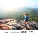 young woman standing with...   Shutterstock . vector #81351673