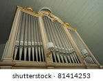 Old church organ in rural wooden church - stock photo