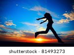 Young Woman Jumping On Meadow...