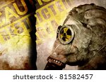 Man In Gas Mask On Cracked Wal...