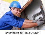 young plumber fitting pipes | Shutterstock . vector #81609304
