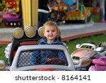 Cute Toddler Boy Riding A Truc...