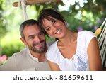 couple sitting in hammock | Shutterstock . vector #81659611