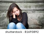 Stock photo outdoor portrait of a sad teenage girl looking thoughtful about troubles 81693892