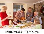family serving christmas dinner | Shutterstock . vector #81745696
