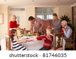 family serving christmas dinner | Shutterstock . vector #81746035