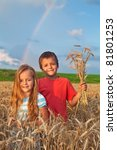 Kids in wheat field at harvest time witnessing nature's blessings - stock photo
