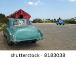 Old green American car at Cuba - stock photo