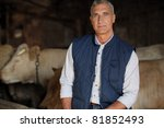 Farmer In His Cow Farm