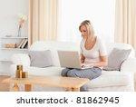 blonde woman using a laptop... | Shutterstock . vector #81862945