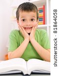Little boy forgot reading - the stress of going back to school concept - stock photo
