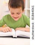Little boy remember reading before school begins - closeup - stock photo