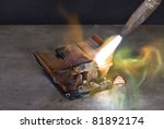 Stock photo melting down a copper cooling element with a blow pipe 81892174