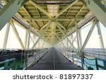 Akashi Kaikyo Bridge in Kobe, Japan, viewed from the pedestrian walkway. - stock photo