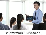 Business man discussing finance chart on a touch pad - stock photo