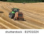 Tractor With Baler Baling Hay