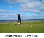 Woman playing golf on a beautiful links course in Northern Scotland - stock photo