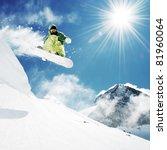 Snowboarder at jump inhigh...