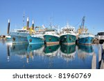 fishing boats in a harbour and...