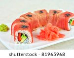 Fuji Sushi rolls made of tuna, pepper, avocado, cucumber - stock photo