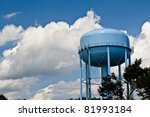 Blue Water Tower Under Cloudy...