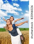 Woman and little girl relaxing and playing outdoors, inspiring freshness - stock photo