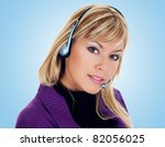 Young beautiful blond girl with a headset working as customer support - stock photo