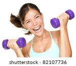 Happy fitness woman lifting dumbbells smiling cheerful, fresh and energetic. Mixed race Asian Caucasian fitness girl training isolated on white background. - stock photo