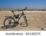 bicycle among a sandy desert | Shutterstock . vector #82130374