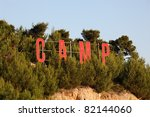 Camp sign in the forest - stock photo