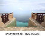 Entrance to Heaven: Steps leading into the Caribbean Sea, merging with the sky, at dusk. - stock photo
