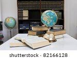 pile of books and globe in... | Shutterstock . vector #82166128